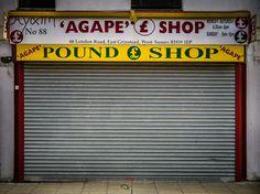 ghost sign for Agape £ Shop, West Sussex, UK