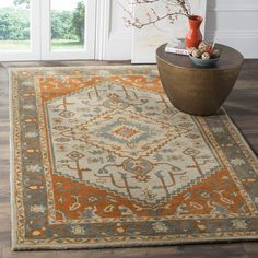 Safavieh Heritage Traditional Oriental Hand-Tufted Wool Light Blue/ Rust Area Rug (4' x 6') (HG406A-4), Size 4' x 6'