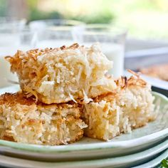 Coconut Butter Mochi --dense, chewy and sticky dessert bars with shredded coconut--a Hawaiian delight! Just Desserts, Delicious Desserts, Dessert Recipes, Yummy Food, Hawaii Desserts, Gourmet Desserts, Plated Desserts, Drink Recipes, Gluten Free Mochi Recipe