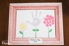 Mother's Day Handprint Flowers 2016. This easy gift idea is sure to be a hit for Mother's Day. Personal art that will last a lifetime.