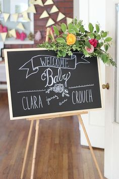 A Rustic and Chic Baby Shower diy chalk letter welcome sign to greet your guests. Use a cafe chalk marker for great control. Add fresh greenery and flowers.Keep them fresh with floral picks. Baby Shower Niño, Shower Bebe, Unique Baby Shower, Floral Baby Shower, Baby Shower Games, Baby Boy Shower, Baby Showers, Bridal Shower, Baby Shower Elegante
