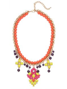Looking for the perfect neon statement necklace for summer?  Well then look no further than the acid bright stones and neon coral beadwork that comprises this electric pendant necklace.