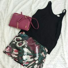H&M Black Top Black tank top 100%Polyester feels like silk. High-low fit, with side slits.   Unfortunately  tag was not attached at store, you can see the tag tie is still on tag. H&M Tops