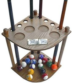 """8 Cue Stick Pool Table Ball Floor Rack with Scorer, Oak Finish by Iszy Billiards. $37.45. 8 Pool cue and ball floor rack - Holds 8 cues and full set of balls - With 4 score counters - Cues and balls not included - Some assembly required - Oak finish - Measurements are 22 1/4""""H X 14""""W X 14""""D"""