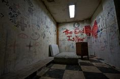 Abandoned asylum. Cool idea for a scene, just draw on the walls with different markers, pens, etc.