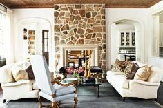 Fieldstone fireplace (similar to my own). This is a look I love! Although I prefer a jute rug and rustic coffee table. Put slipcovers over these sofas for practicality, and maybe a cowhide sling chair instead...;)