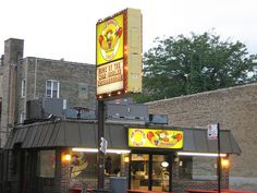 Weiner Circle on North Clark, Chicago.  The workers smack talk back to the customers.