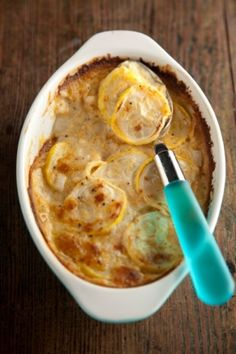 Squash Casserole--PAULA DEEN  1/2 c sour cream, 1 c Ritz crackers, 6 c raw squash, 4 Tbsp butter, 1 large onion, 1 c grated cheddar cheese, 1 c water