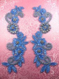 Pastel blue and silver sequin applique mirror pair