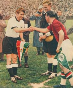 West Germany 3 Hungary 2 in 1954 in Berne. The captains meet before the World Cup Final.