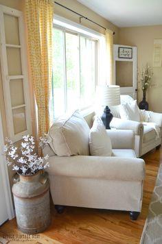 Farmhouse Living Room Summer -love the milk can vase