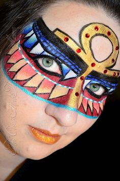 Cleopatra Egyptian inspired make-up mask accented with red jewels.