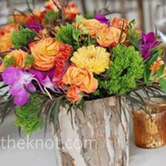 ? table centerpiece?? using wedding colors of white, chocolate and orange, maybe tie a thin bow around the center of vase.