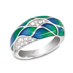 Pacific Azure Ring - Smooth enamel, as cool and clear as the Pacific Ocean, artfully adorns this unique sterling silver ring. Plated in precious rhodium and accented with sparkling imitation diamonds in gorgeous wave formations, this stunning piece re-creates the ocean in all its colourful glory.