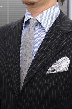 Suits,double cuff shirts,wooltie and silk chief
