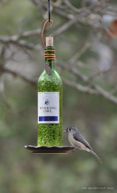 Wine Bottle DIY Crafts - Wine Bottle Bird Feeder  - Projects for Lights, Decoration, Gift Ideas, Wedding, Christmas. Easy Cut Glass Ideas for Home Decor on Pinterest http://diyjoy.com/wine-bottle-crafts