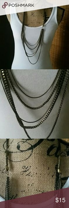 Long multi strand antique gold necklace This long multi strand necklace ha antique gold chains that are graduated in length.  It's understated beauty will compliment your entire wardrobe. Jewelry Necklaces