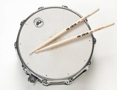 Sticks on a snare drum.
