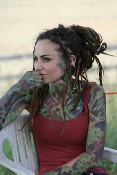 Although I wouldn't axactally put this women in the same class as the rest of these freaks on this board, she still has wayyyy too many tattoos, but nice dreads. She actually looks normal compared to them. Tattoo Girls, Girl Tattoos, Crazy Tattoos, Full Body Tattoo, Body Art Tattoos, Piercings, Dreads Girl, Hippie Dreads, White Girl Dreads