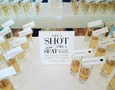 "Wedding ideas for a seating chart—shots seating charts with a sign that reads . - Wedding ideas for a seating chart—shots seating charts with a sign that reads ""Take a shot and - Wedding Table Planner, Bridal Planner, Wedding Favor Table, Wedding Games, Wedding Signs, Table Names For Wedding, Wedding Favors, Wedding Invitations, Wedding Souvenir"