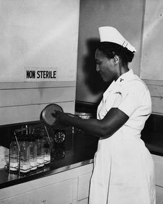 """Army Nurse Mattie Donnell Hicks handles medical supplies at a counter in an area marked """"non sterile,"""" circa 1950.  Credit: Jackson Library, The University of North Carolina at Greensboro."""
