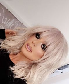 Short, layered haircut with bangs-- looks gorgeous on platinum hair.