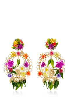 These **Mercedes Salazar** earrings are precisely what their name entails, a celebration of the designer's Columbian heritage. A mix of tassels and beads, these earrings certainly statement your evening look.