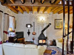 An efficient wood-burning stove which cosily heats this enchanting little holiday cottage. Cosy Lounge, Open Fires, Somerset, Interior Decorating, Decorating Ideas, Home Appliances, Living Room, Wood Burning, Cottages