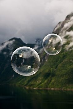 Clear soap bubbles over the fjord. シャボン玉,