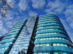 Low Angle Photography of Blue Tinted Glass Buildings  Free Stock Photo