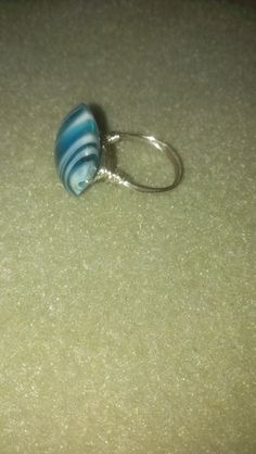 the big brown glass bead.... maybe swirls on sides by stone?