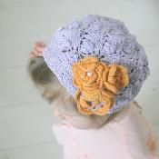 Lace hat Violet with crochet flowers - via @Craftsy