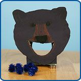 Feed the Bear game ... toss blueberries (blue pom poms) into the bear's mouth.