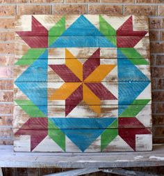 """A large 33"""" x 33"""" Barn Quilt with a Tulip and Star pattern, finished for use indoors and out."""