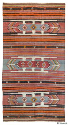 Vintage kilim rug handwoven in 1960's in Sivas in Central Anatolia, Turkey. It is in very good condition.