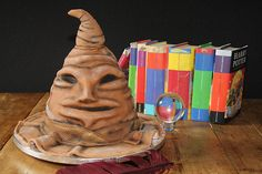 """Harry Potter Sorting Hat Cake by Quirky Confectioner. Maybe I could put something in a sorting hat cake so when each kid got their piece they would find out what """"house"""" they were in. Harry Potter Theme Cake, Harry Potter Treats, Gateau Harry Potter, Cumpleaños Harry Potter, Harry Potter Birthday Cake, Harry Potter Sorting Hat, Harry Potter Universal, Pastel Harry Potter, 16 Birthday Cake"""