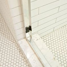 white penny tile with dark gray grout as border for bath 3