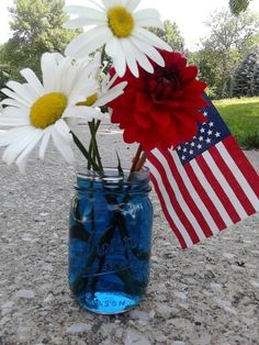 Patriotic decorations - mason jar vases with blue food coloring