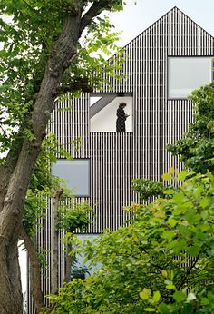 Square windows puncture the fabulous facade (reclad in strips of wood) of this Puinstraat townhouse in Ghent, Belgium designed by FELT & 360 Architecten. via dezeen