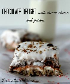 Chocolate delight with pecans and cream cheese is a go-to dessert for the holidays or any day! http://thecountrycontessa.com/2013/12/04/chocolate-delight-dessert-recipe/