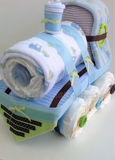 Brown and green diaper train diaper cake. by Gottagetadiapercake