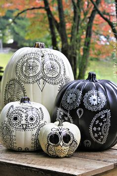The power of  black and silver Sharpies goes a long way! Blogger Ashley Hackshaw designed a these intricate owls for a festive and creative display. Get the tutorial at Lil Blue Boo.   - CountryLiving.com