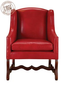 Modern traditional at #lvmkt - Leathercraft's wing #chair tempts in red #leather. (A-0130) The shapely stretcher showcases the company's domestic manufacturing capabilities. Fabric and COM are available.