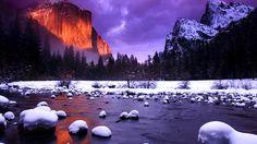 Yosemite National Park, California  The setting sun illuminates El Capitan monolith in frozen Yosemite National Park.