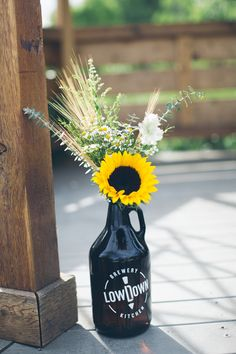 Altar decor. Sunflower wedding. Beer themed wedding. Growler. Wild flowers. Botanic garden wedding. Photo credit: Emilyelizabethphoto.com  Joliefloral.com
