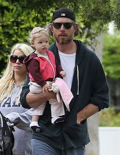 Eric Johnson held daughter Maxwell during a family walk on Sunday.