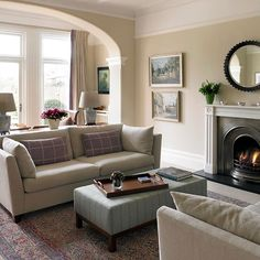 Traditional living room, calm pastels, relaxing paint scheme and with the beautiful black brushed steel fire, a cozy look too!