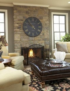 Stone Fireplace with oversized clock....warm and inviting