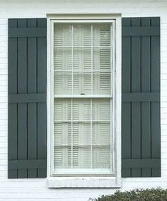 Board & Batten shutters, with small gap between boards.  Includes tutorial for building them.