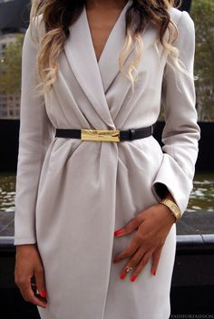 Sophisticated wrap dress with edgy accessories for a bold and fashionable look great from day to night.
